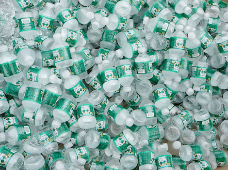 A pile of half-pint Poland Spring bottles, a brand manufactured by a Nestlé subsidiary. (Image Credit: Brett Weinstein)